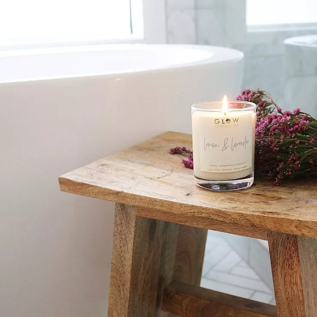 Lemon and lavender candle next to bathroom. Photo by Instagram user @glowcandleco