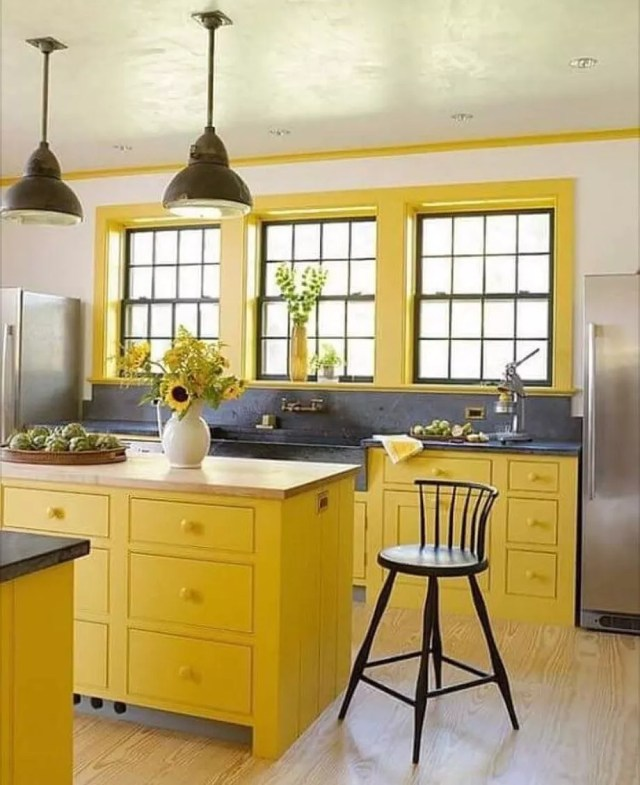 Kitchen with yellow cabinets and window trim. Photo by Instagram user @homenhance
