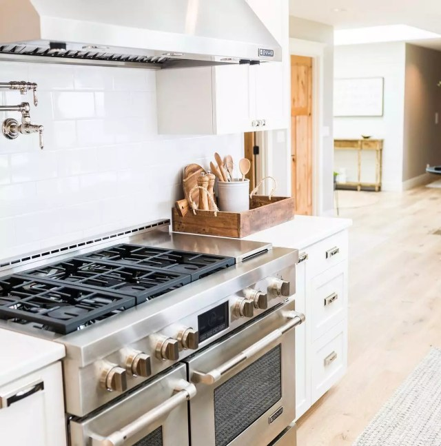 Kitchen stainless steel stove. Photo by Instagram user @cornerstone.builders