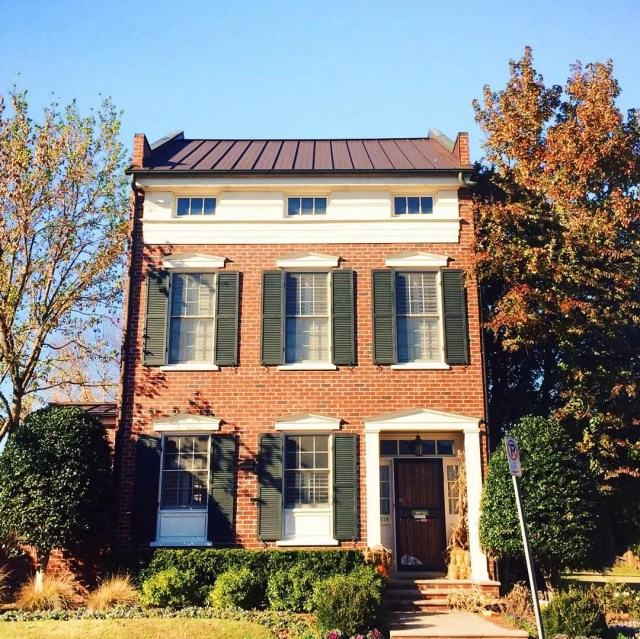 Two-story single-family brick home with black trim. Photo via Instagram user @mohothenomad