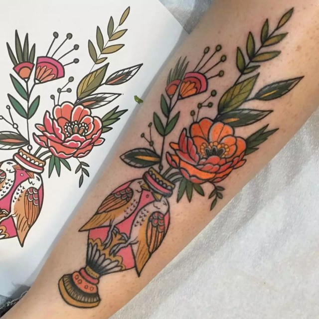 Arm with a Colorful Tattoo of Birds and Flowers. Photo by Instagram user @emilierobinsontattoo