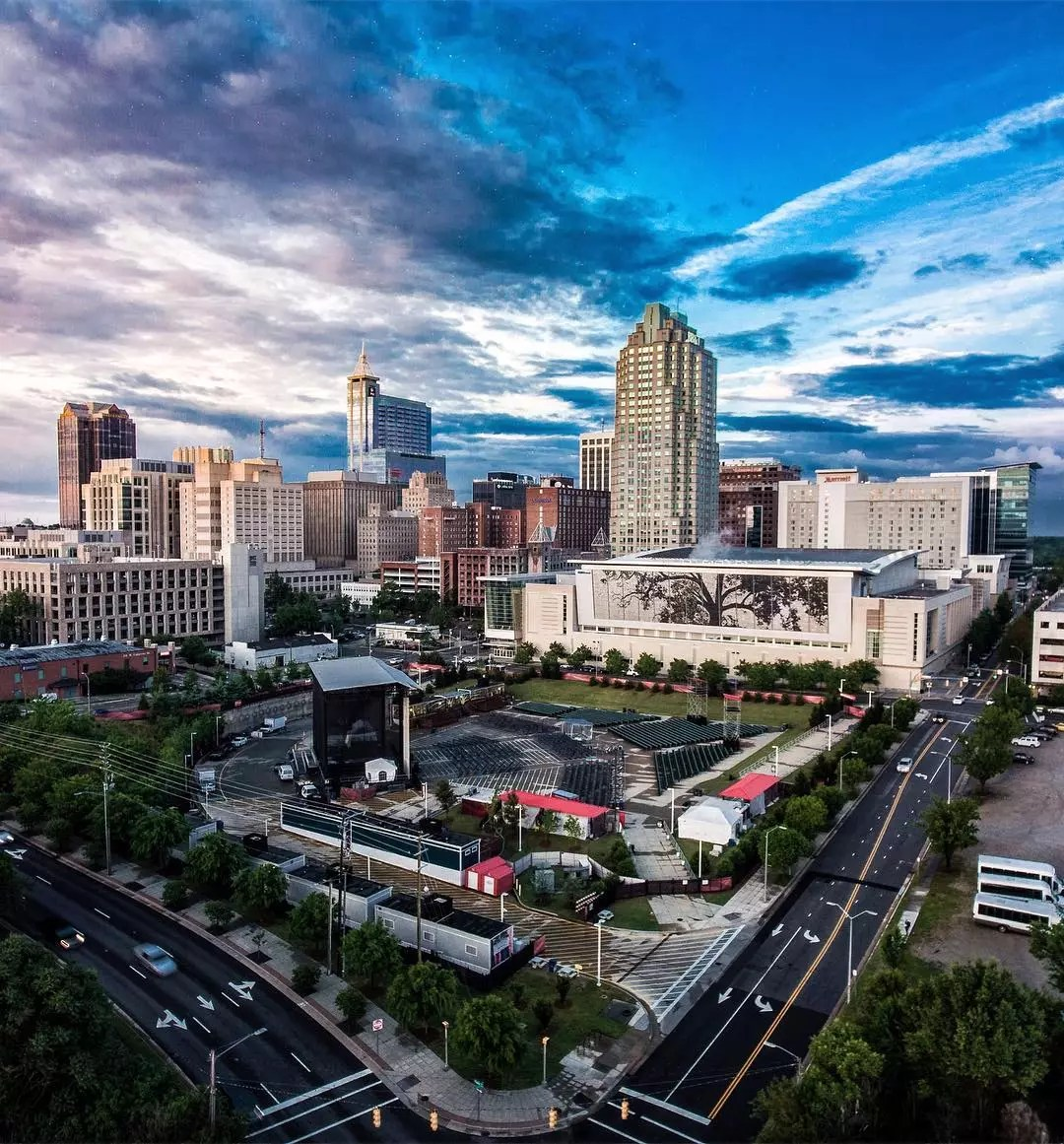 Downtown Skyline of Raleigh NC photo at dusk photo by Instagram user @visitraleigh