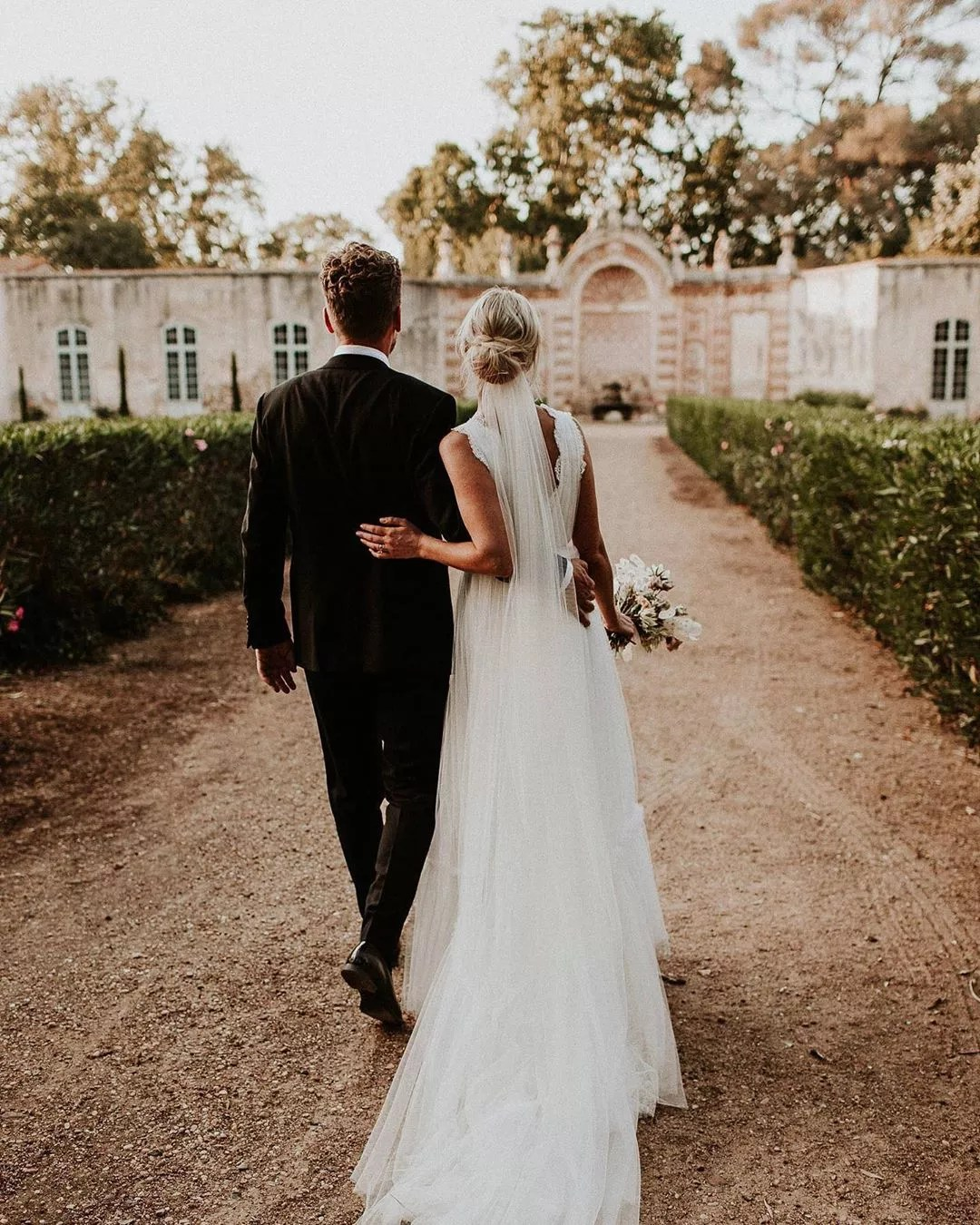 Couple Walking Down the Aisle at Beaulieu Garden in Napa Valley. Photo by Instagram user @dceybridal