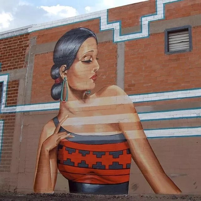 Mural of a woman created by artist Nani Chacon painted on the side of a building. Photo by Instagram user @visitabq