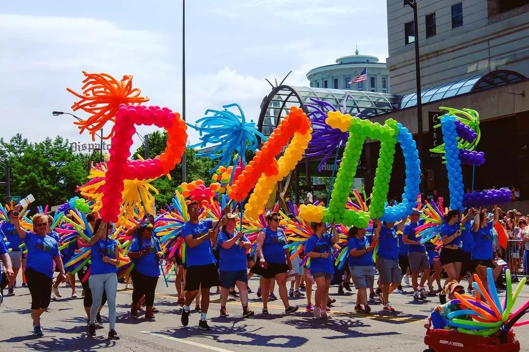 People holding balloons that spell PRIDE during a parade. Photo by Instagram user @yayitsm4tt