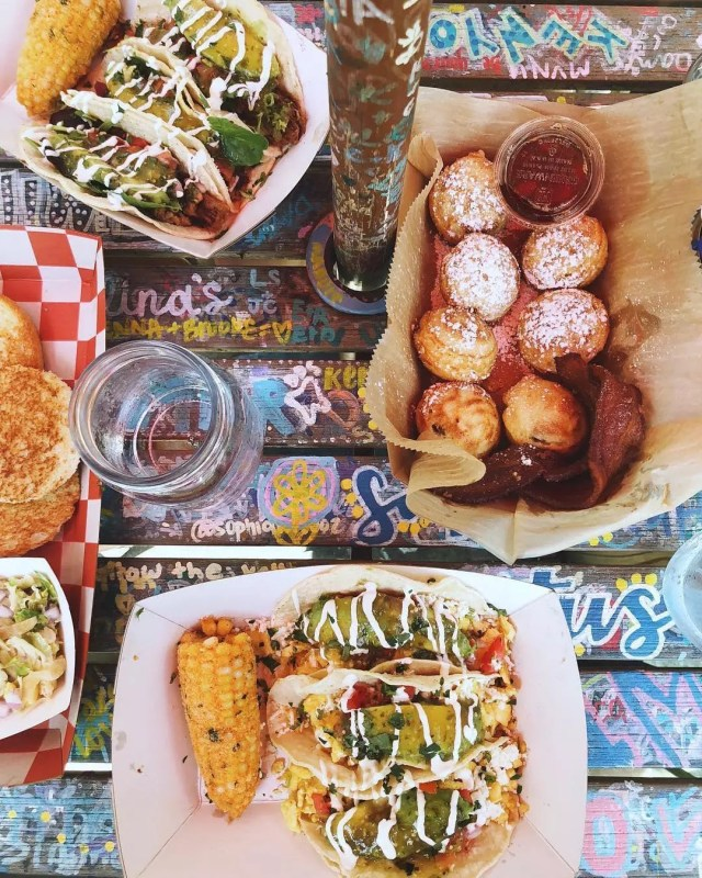 Overhead view of tacos, corn, and more on a table. Photo by Instagram user @katalinascafe