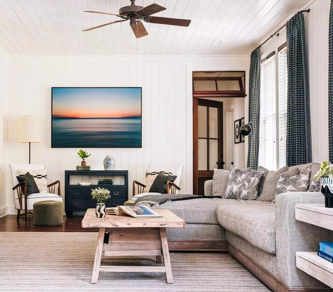 Living room with modern ceiling fan. Photo by Instagram user @cortneybishopdesign