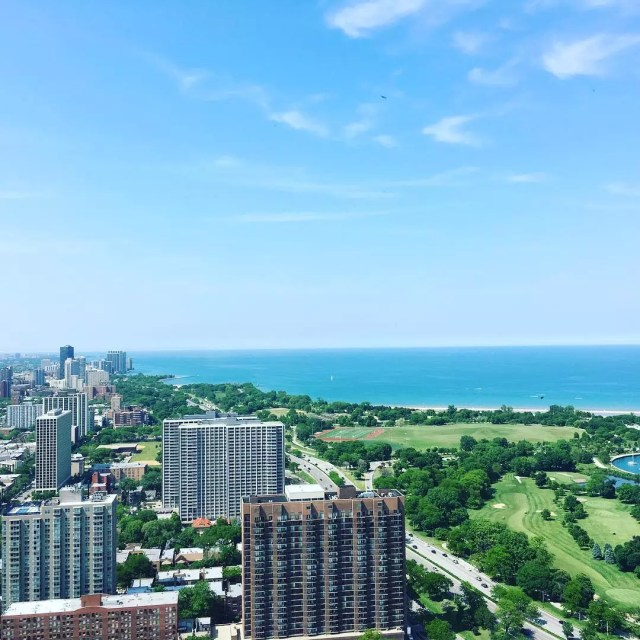 Skyscrapers and golf courses on a sunny day in Lake View, Chicago. Photo by Instagram user @sweetspotrealty