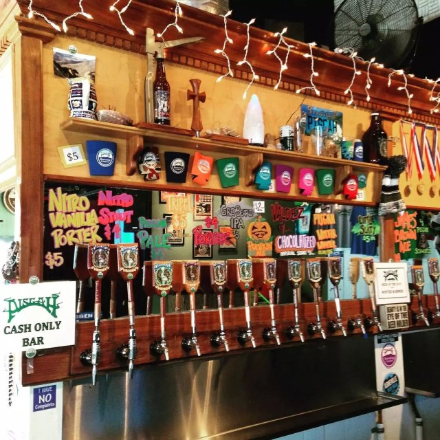Line of beer taps at Pisgah Brewing. Photo by Instagram user @ashevillebrewscruise
