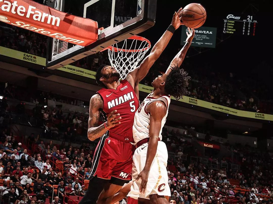 Two basketball players jumping for the ball at AmericanAirlines Arena in Miami FL. Photo by Instagram user @miamiheat