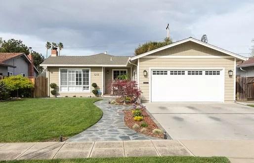 Tan home with green lawn in West San Jose. Photo by Instagram user @juliedavissellshomes