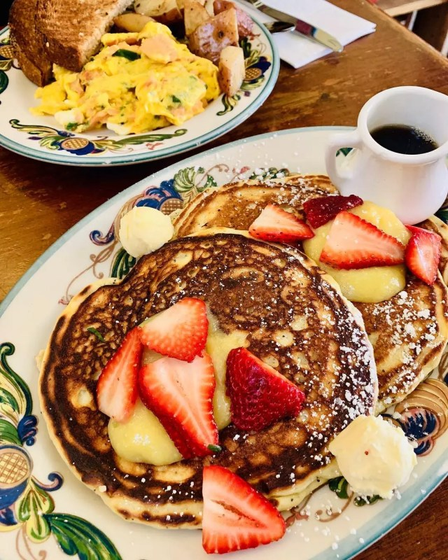 Plate of pancakes with strawberries from Zazie. Photo by Instagram user @eatinwithcorinna