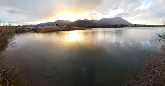 Lake view with mountains in the back at Fort Carson, CO. Photo by Instagram user @soluda_