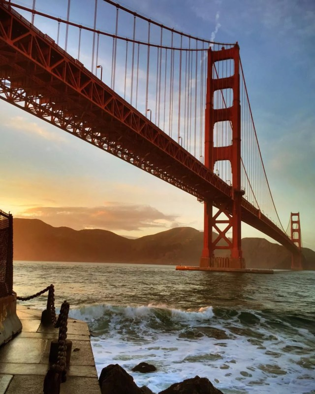 The red Golden Gate Bridge at sunset. Photo by Instagram user @ludditeking