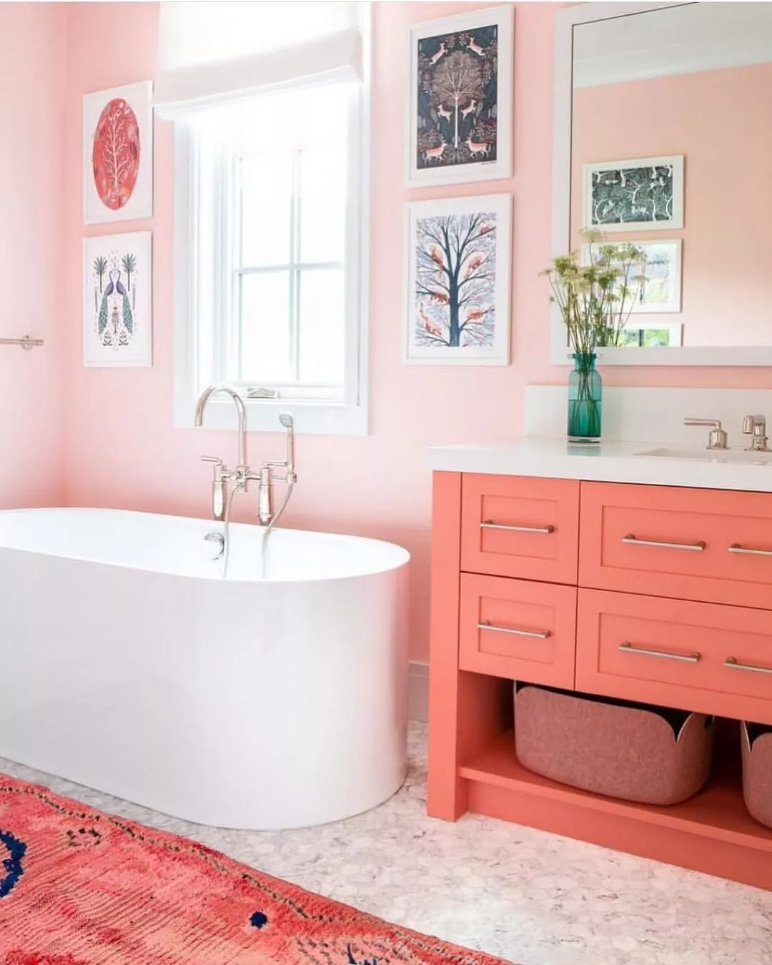 Bathroom with all pink walls and counters and bathtub. Photo by Instagram user @selliottphoto