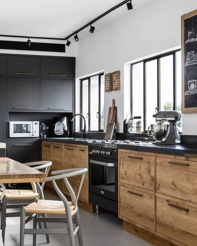 Black and gray and wood kitchen designed in Industrial style. Photo by Instagram use @arpinharutunian