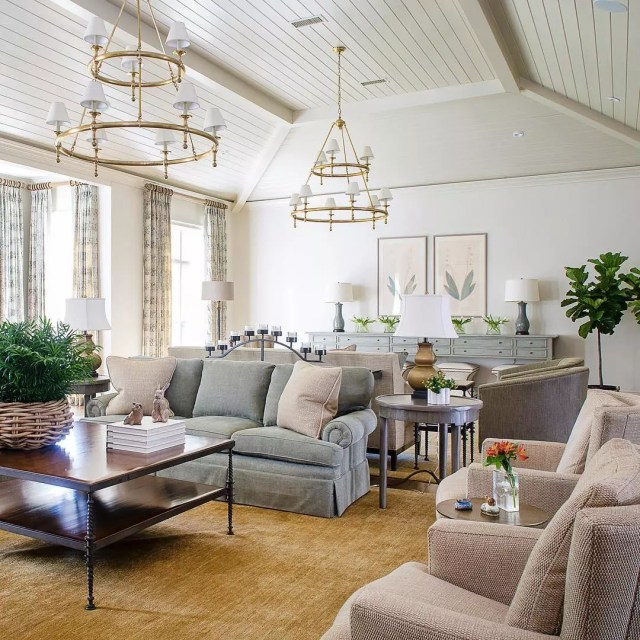 Living room design in Transitional style with gray and blush furniture with gold light fixtures. Photo by Instagram user @cindymccorddesign