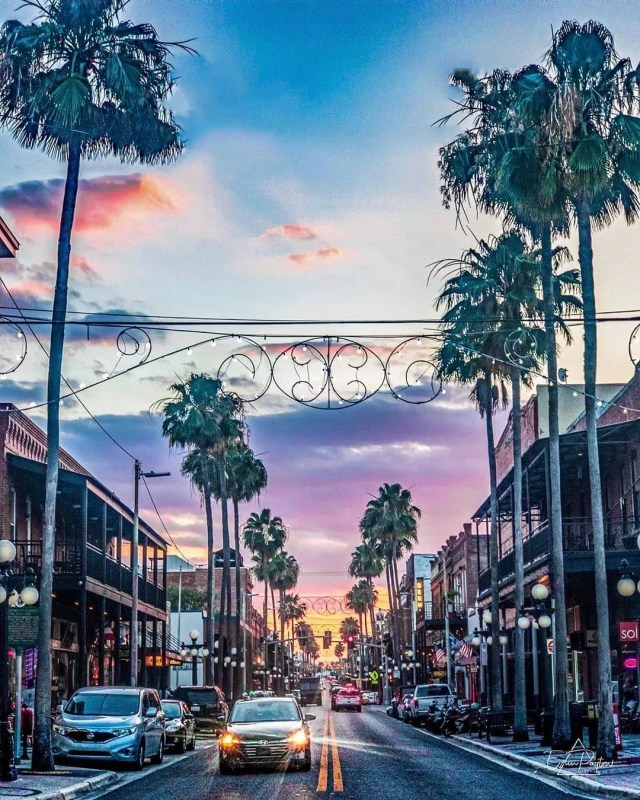 Street view of Ybor City with purple skies as the sun sets. Photo by Instagram user @erinpaytonphotography