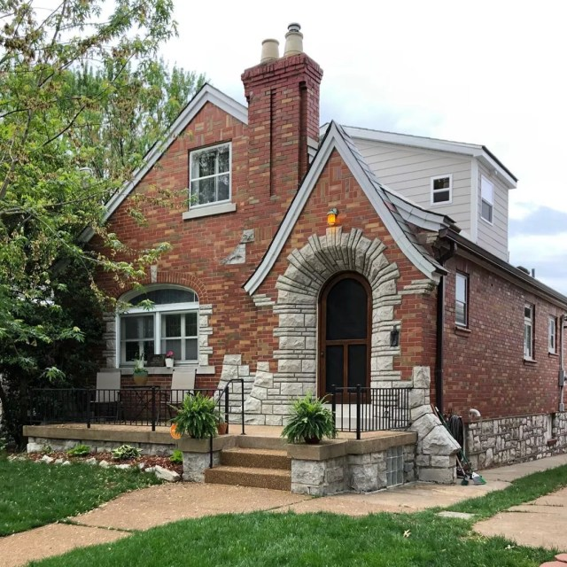 Two-story brick house with green lawn in Boulevard Heights, St. Louis. Photo by Instagram user @bradfose