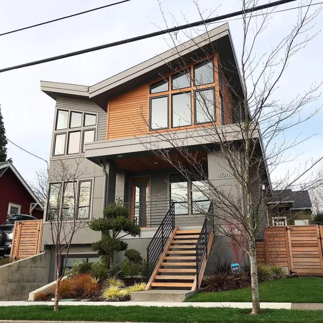 Gray and brown modern house with big windows. Photo by Instagram user @portlandhomestories