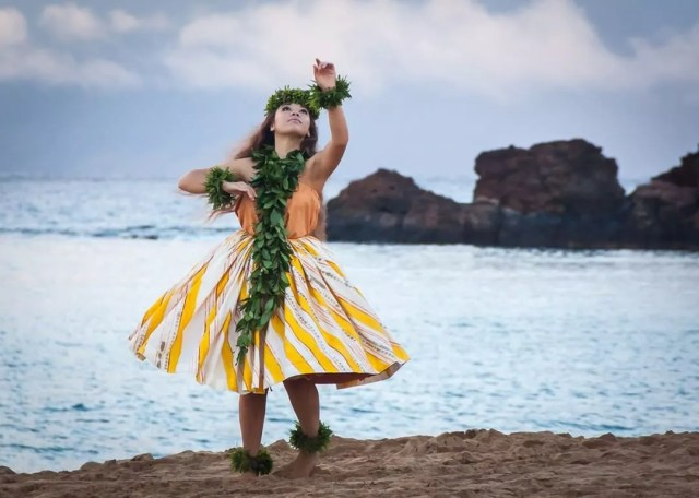 Young girl going the hula on the beach. Photo by Instagram user @aloha_avenue