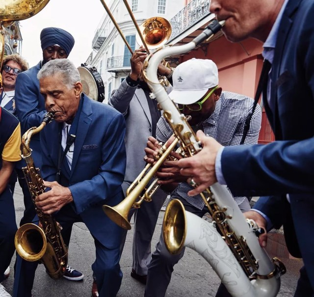Group of men playing the saxophone on the street. Photo by Instagram user @originalpenguin