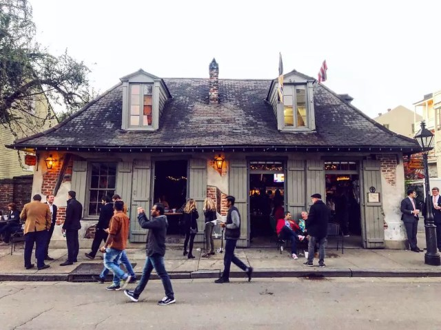 People walking in front of a bar that looks like a house. Photo by Instagram user @scottshilstone