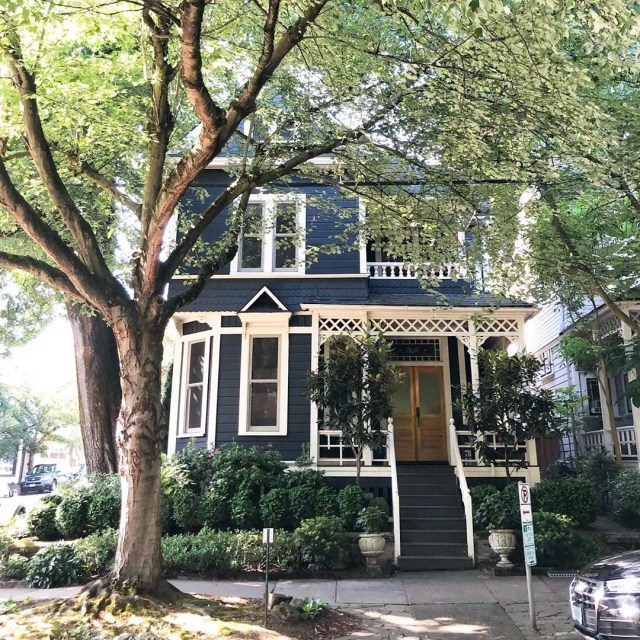 Navy Victorian house with cream trim in Northwest District, Portland. Photo by Instagram user @abbyenyquist