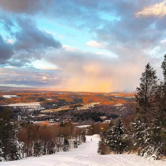 Sunrise over snowy mountains in The Poconos, PA. Photo by Instagram user @johnjward