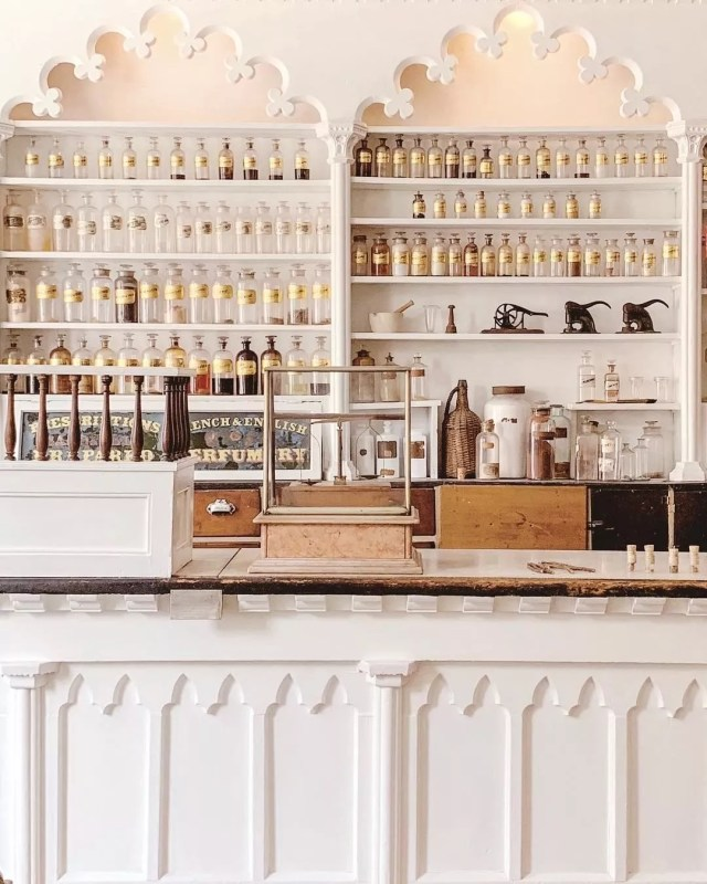 Museum with white walls and old medicine bottles. Photo by Instagram user @skylar_arias_adventures