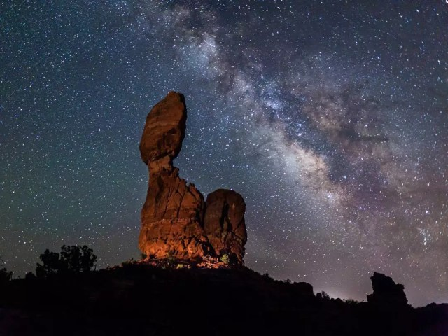Red rock formation under a starry sky at Arches National Park, UT. Photo by Instagram user @colindyoungphotography