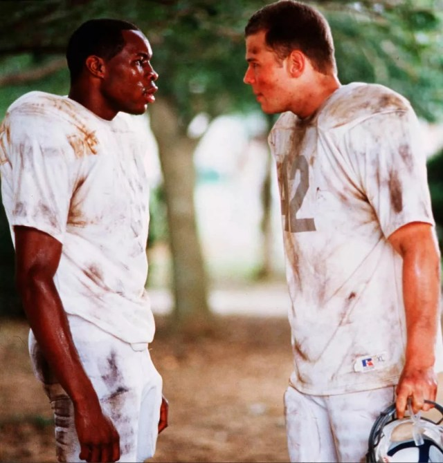 White football player and African football player talking from Remember the Titans. Photo by Instagram user @aleshashinobi