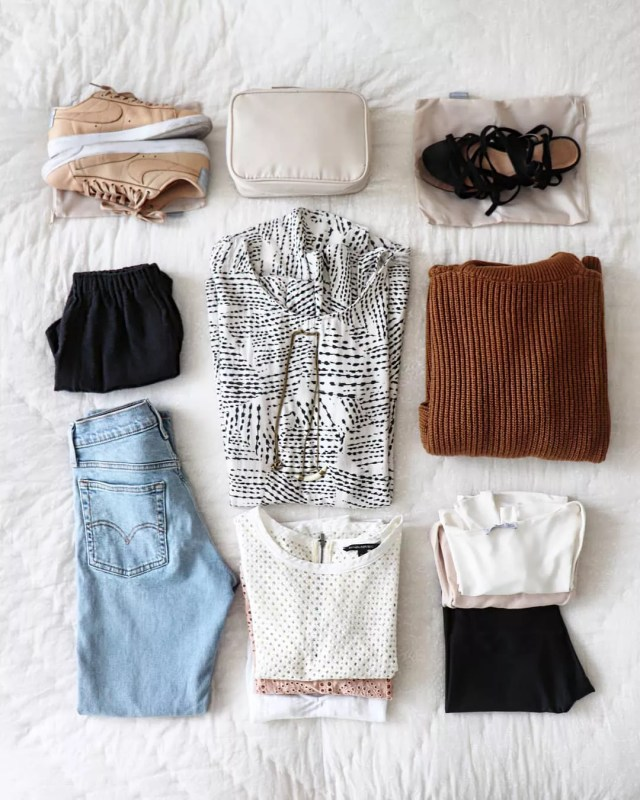 Neutral clothing items and shoes laid out on a bed. Photo by Instagram user @latina.minimalista