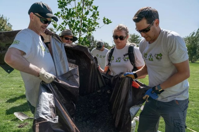 Extra Space Storage team members work together to plant trees in Constitution Park, Salt Lake City, UT
