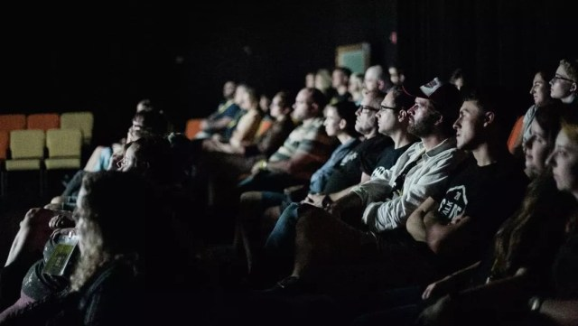 People sitting in a theater watching a movie at the Sidewalk Film Festival. Photo by Instagram user @sidewalkfilm