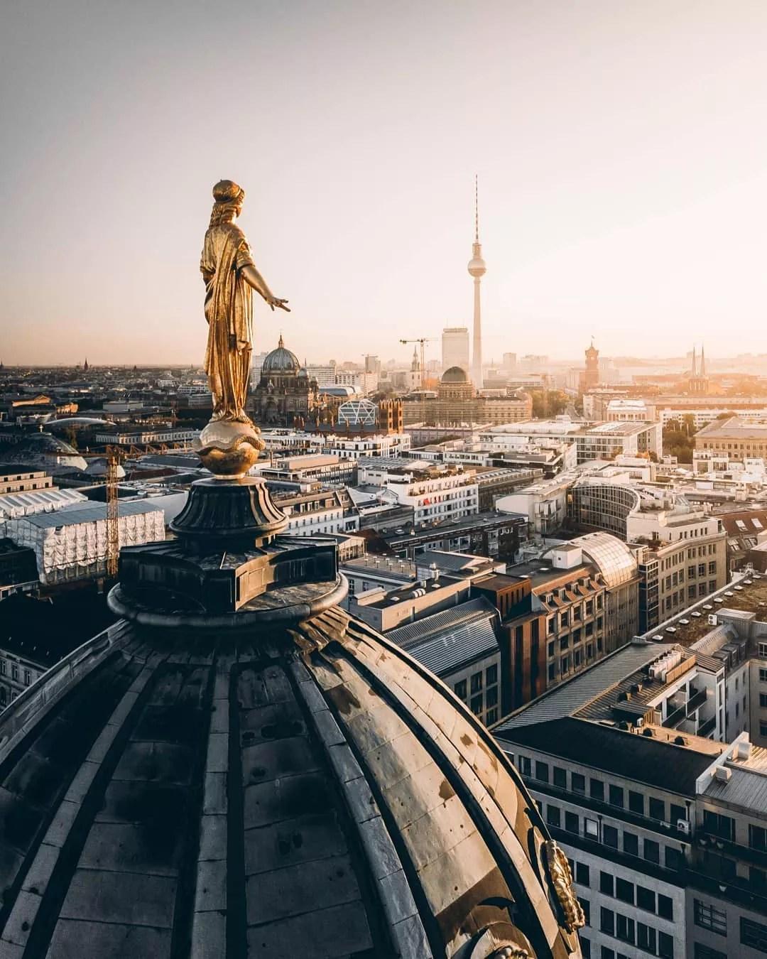 Skyline of Berlin gold statue on church. Photo by Instagram user @ferditakesphotos