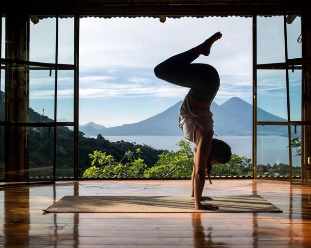 Yoga instructor posing in Lake Atitlan. Photo by Instagram user @yogawithgabby