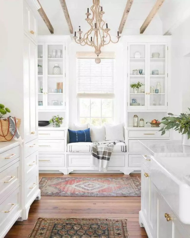 White kitchen with natural light. Photo by Instagram user @interiorsbyherlong