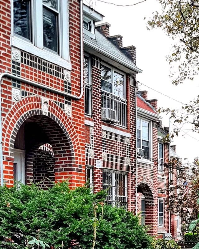 Red brick house with white trim. Photo by Instagram user @rochdalian