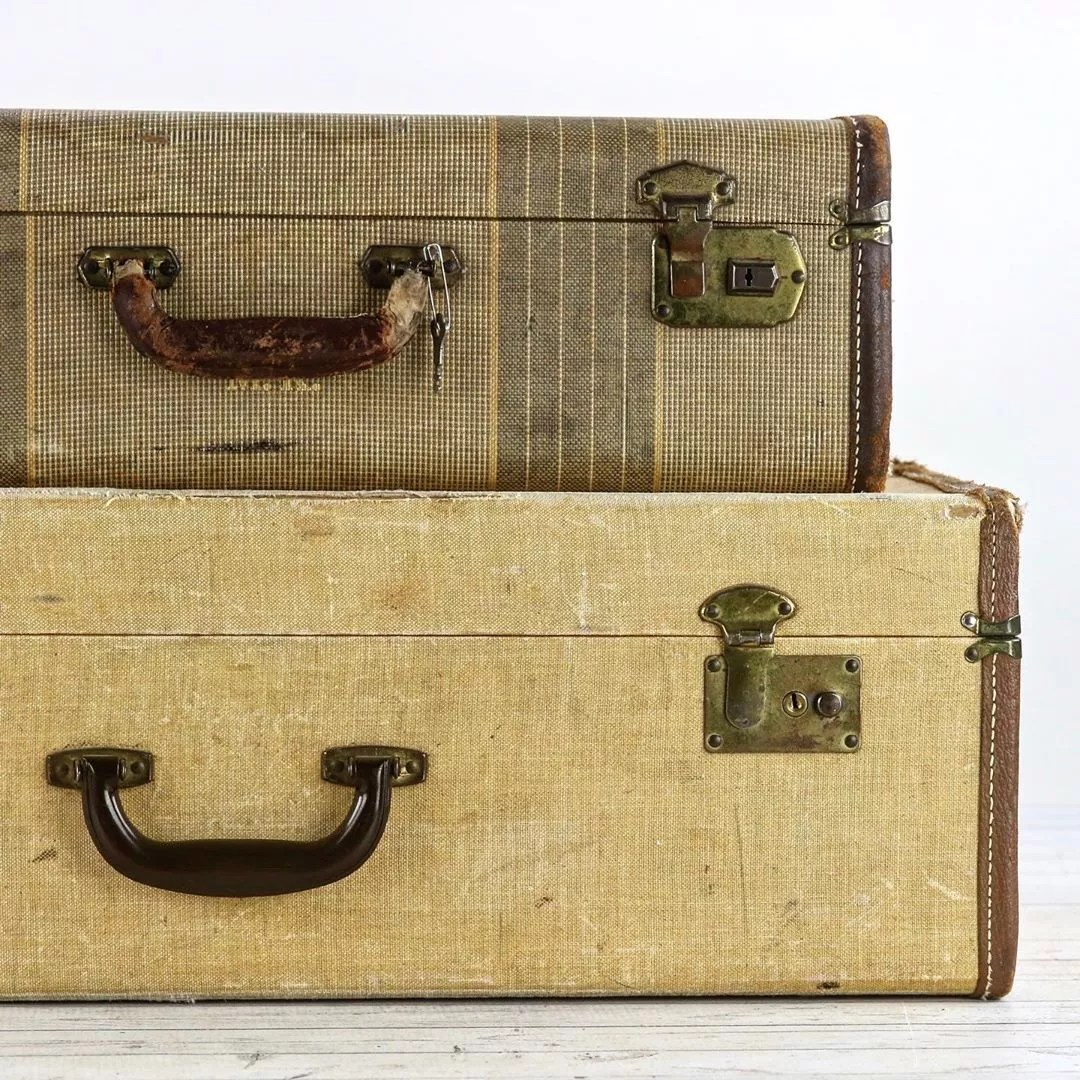 Two brown vintage suitcases stacked. Photo by Instagram user @huntandfound