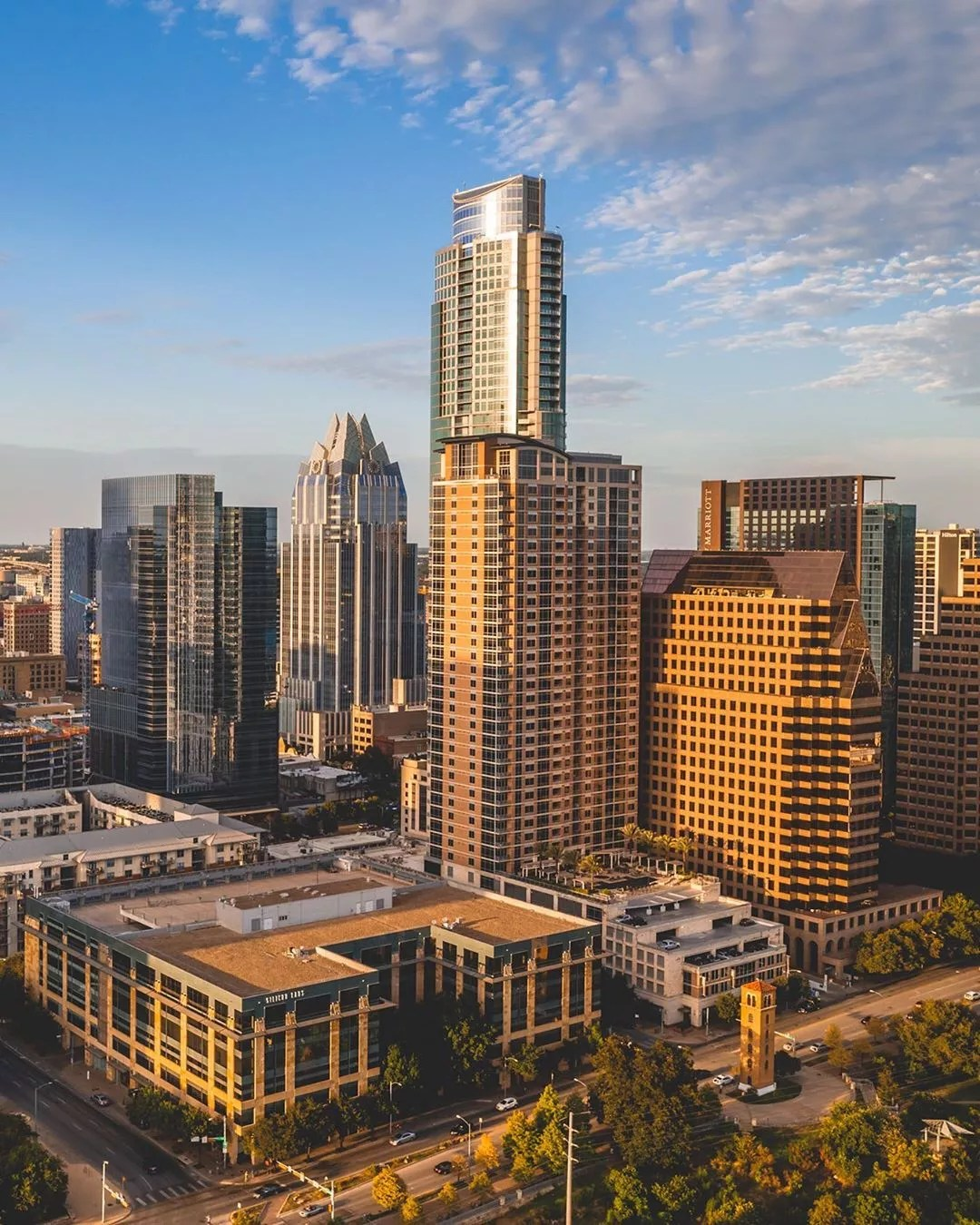 Sun shining on tall buildings in Downtown Austin, TX. Photo by Instagram user @flowkyte