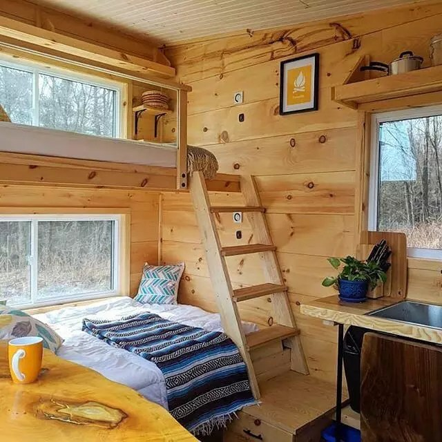 Bunk bed in a tiny home with wood walls. Photo by Instagram user @tinyhouse.minimaison