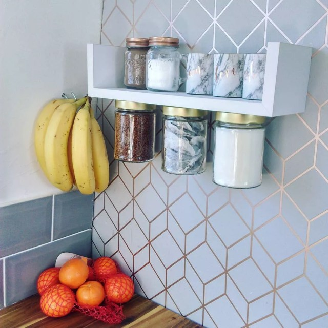 Decorative wall with shelf that has jars on both sides. Photo by Instagram user @ourlittleboatcatherine