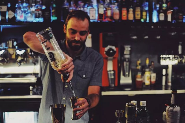Bartender pouring a cocktail. Photo by Instagram user @ponyboyokc