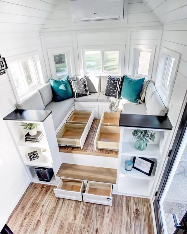 Benches with pullout drawer storage underneath. Photo by Instagram user @moderntinyliving