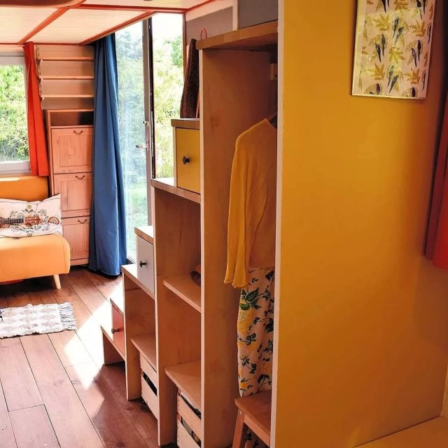 Clothes in under stairs storage cabinets. Photo by Instagram user @tinyhousekusku