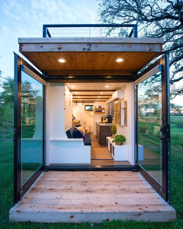 Tiny home porch with giant glass doors. Photo by Instagram user @cargo_home
