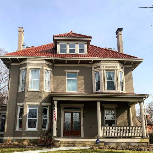 Brown American Foursquare house with red roof in Pleasant Ridge, Cincinnati. Photo by Instagram user @cincinnati_revealed