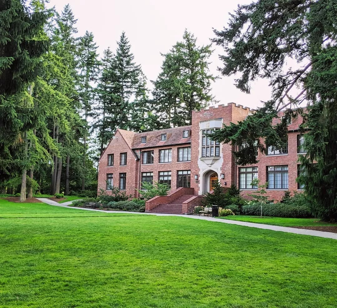 Red brick buildings by green lawn at University of Puget Sound. Photo by Instagram user @ekelly80