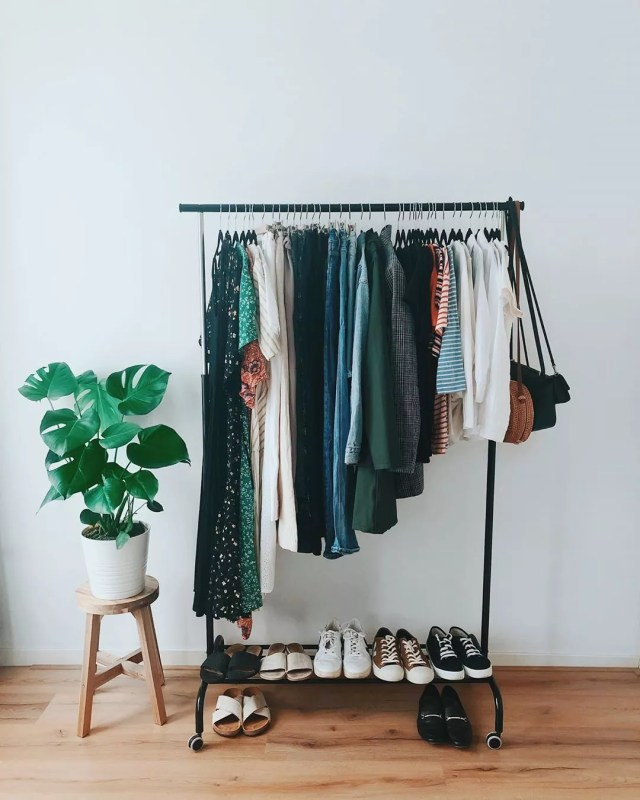 Clothes hanging on a rolling rack. Photo by Instagram user @selinasinspiration
